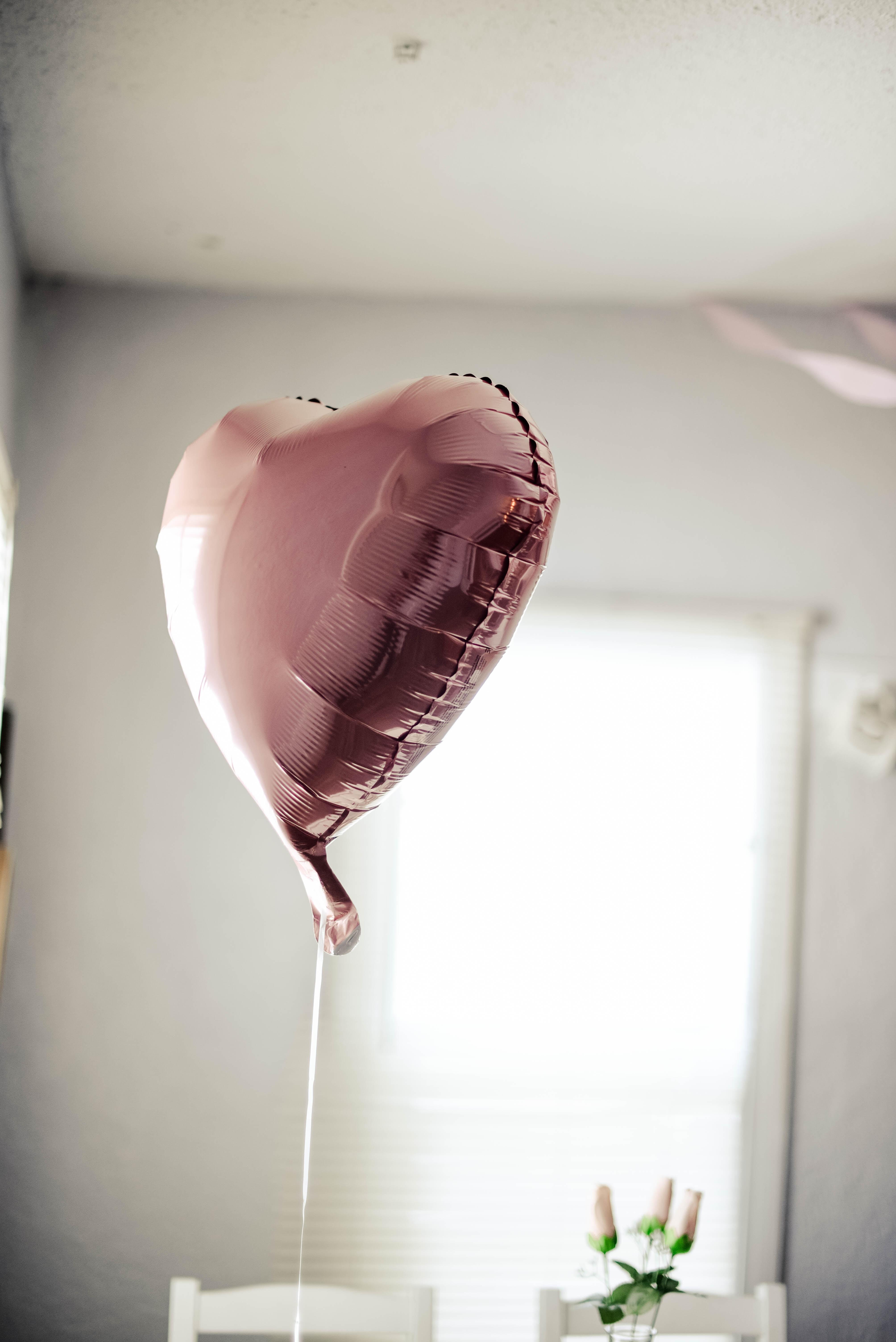 gray balloon on table