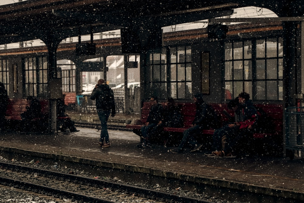 people sitting near station during winter