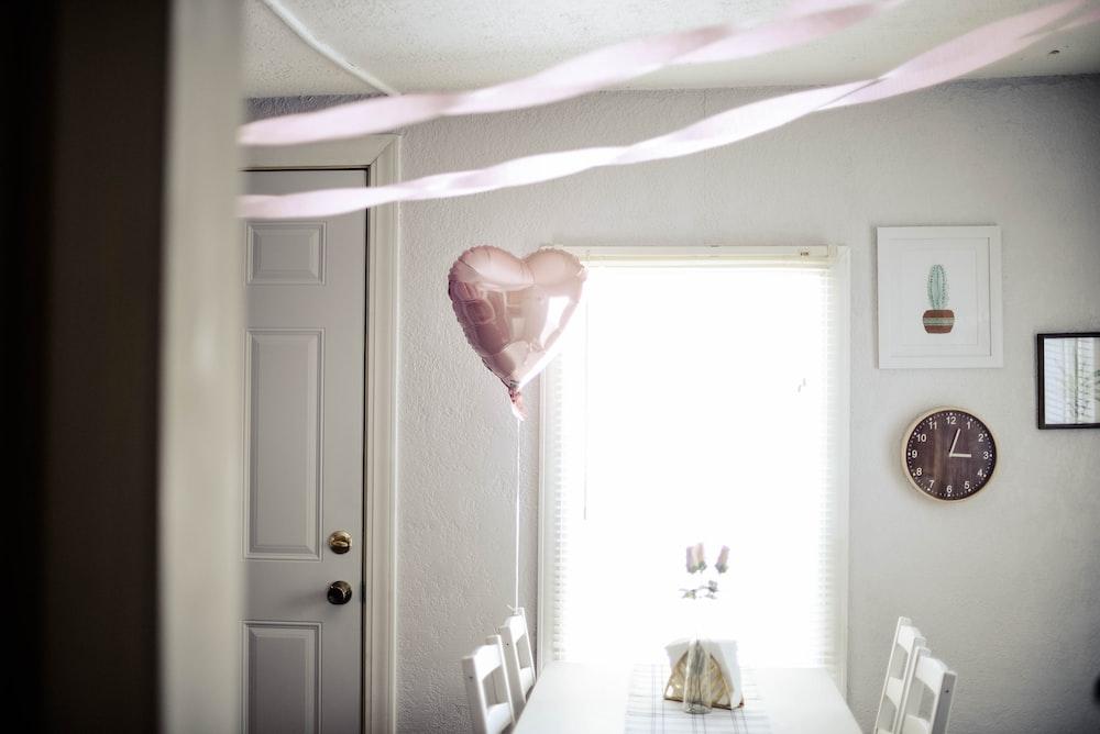 heart balloon tie on chair