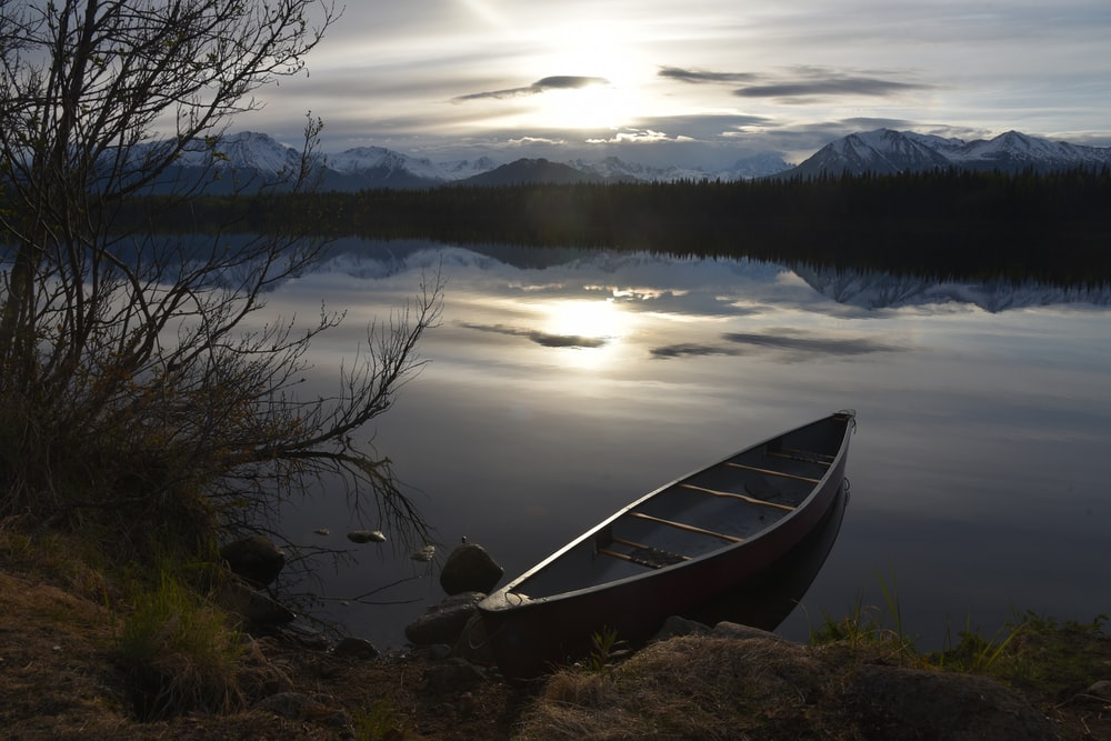 gray kayak on body of water