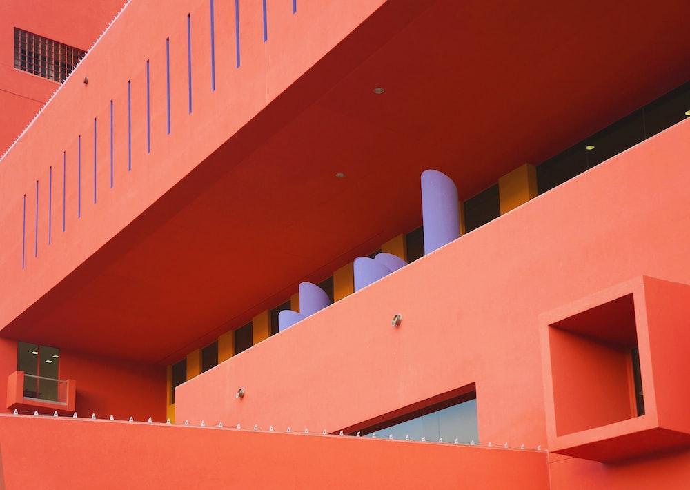 orange wall building closeup photography