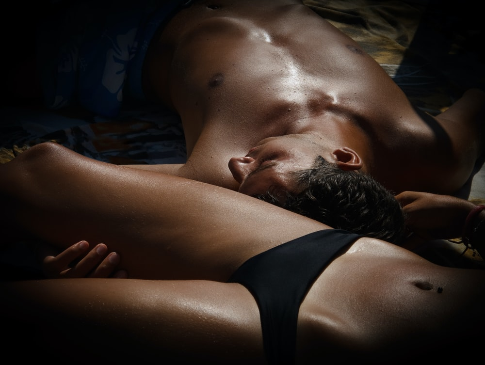 photography of man and woman resting