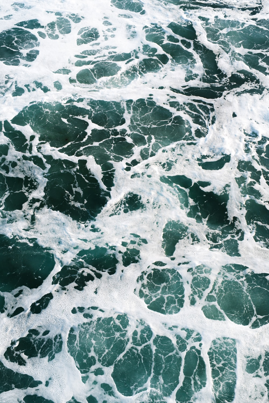 photo of teal sea waves