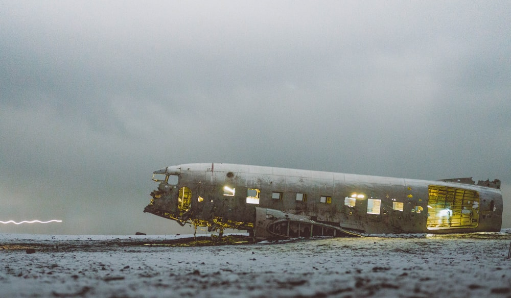 abandoned plane under white sky