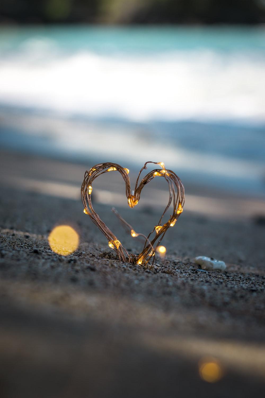 macro photography of heart shape sand decor