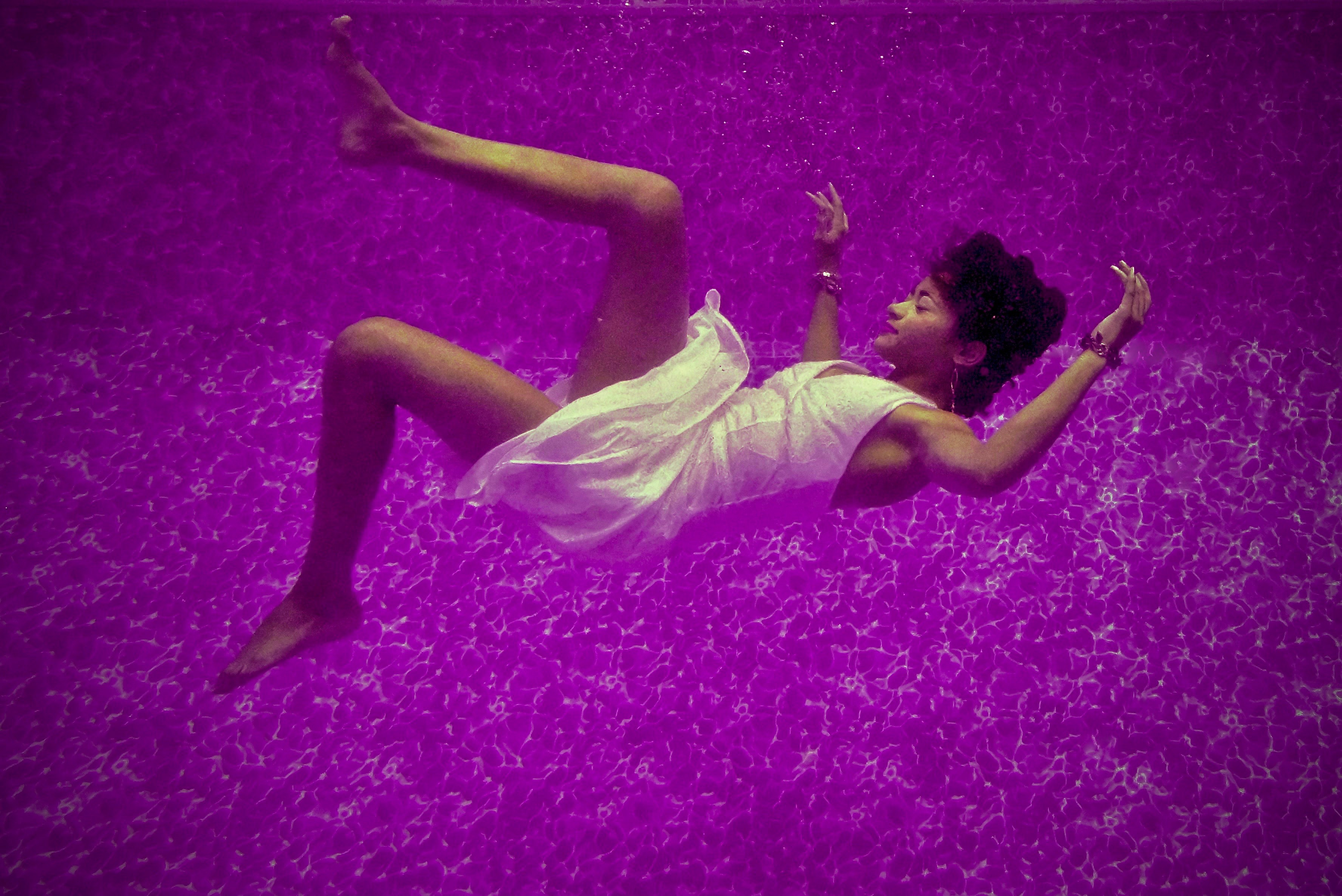 woman falls on purple surface