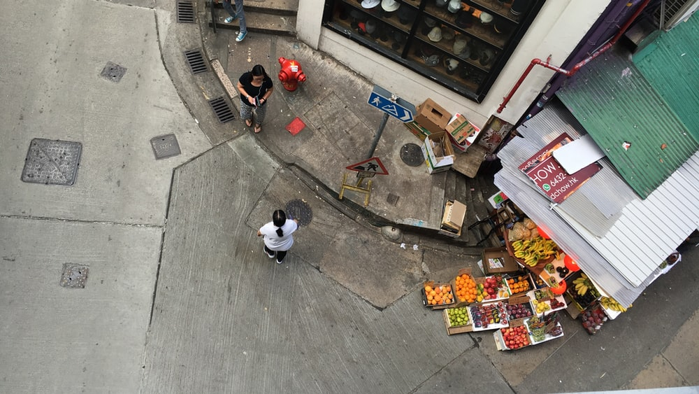top view of person standing near building during daytime
