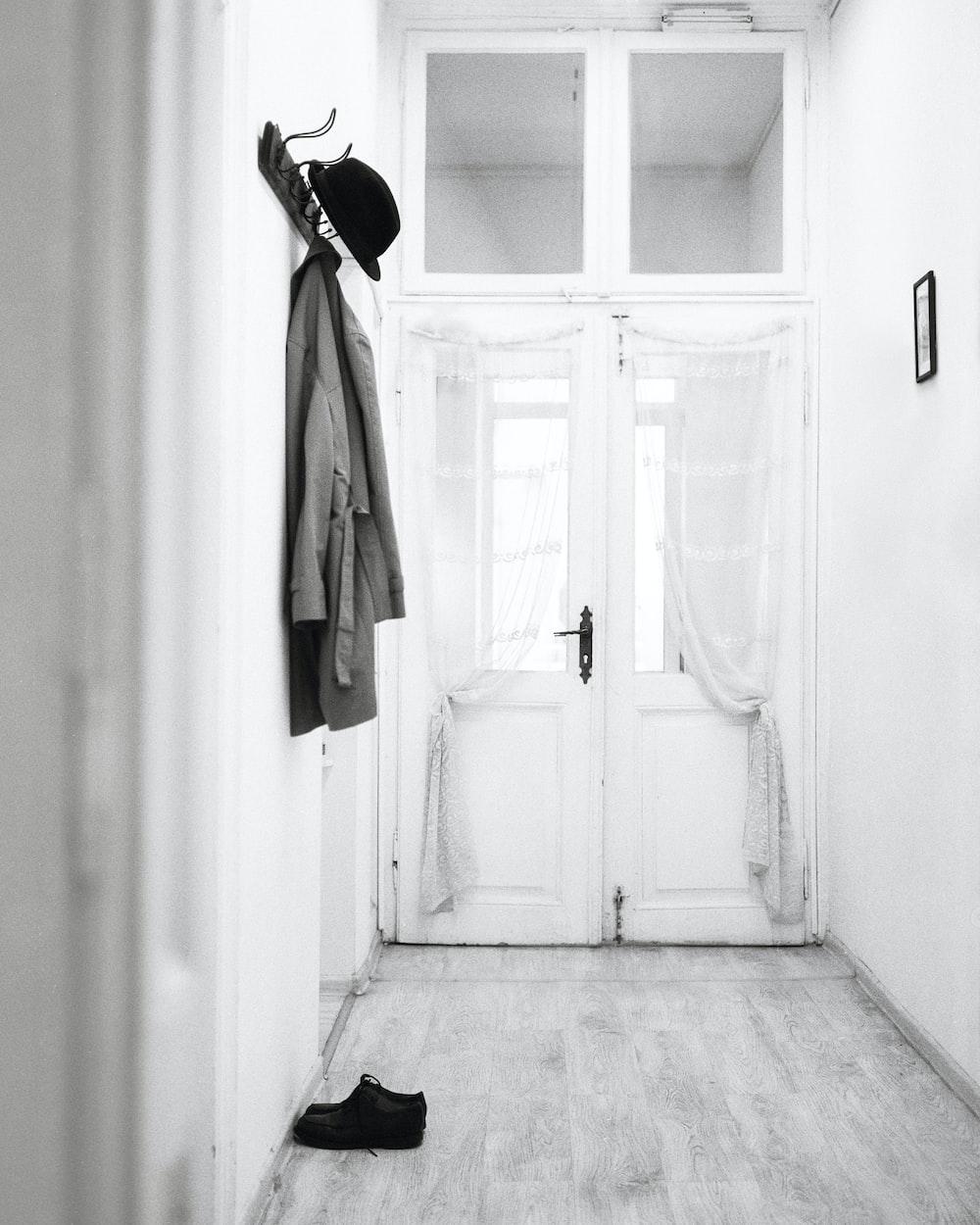 coat hanged on wall hooks