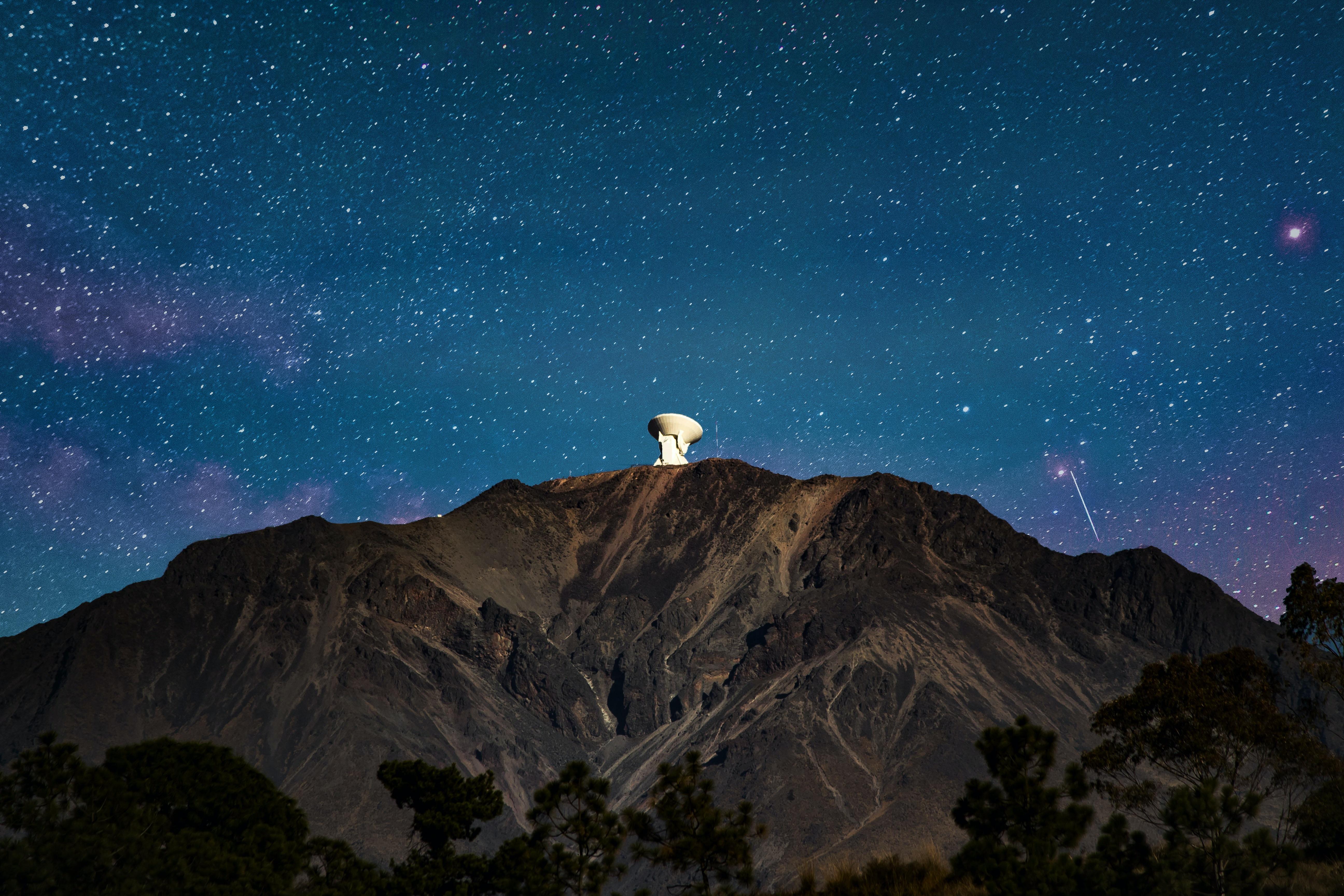 satellite on mountain peak during night time