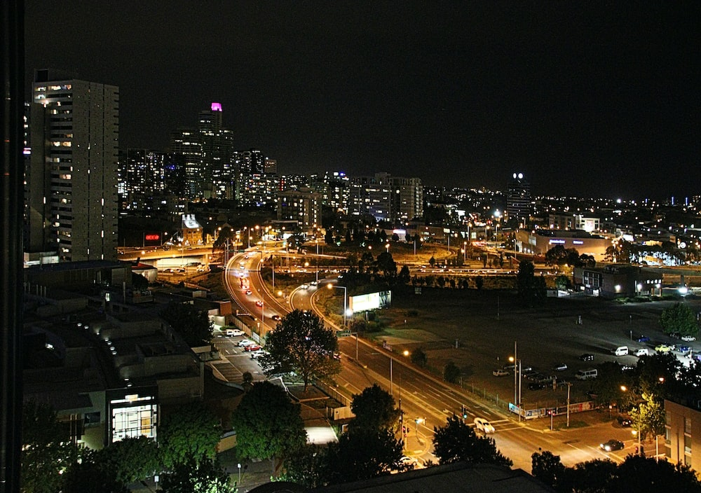 city buildings during nighttime in time lapse photography
