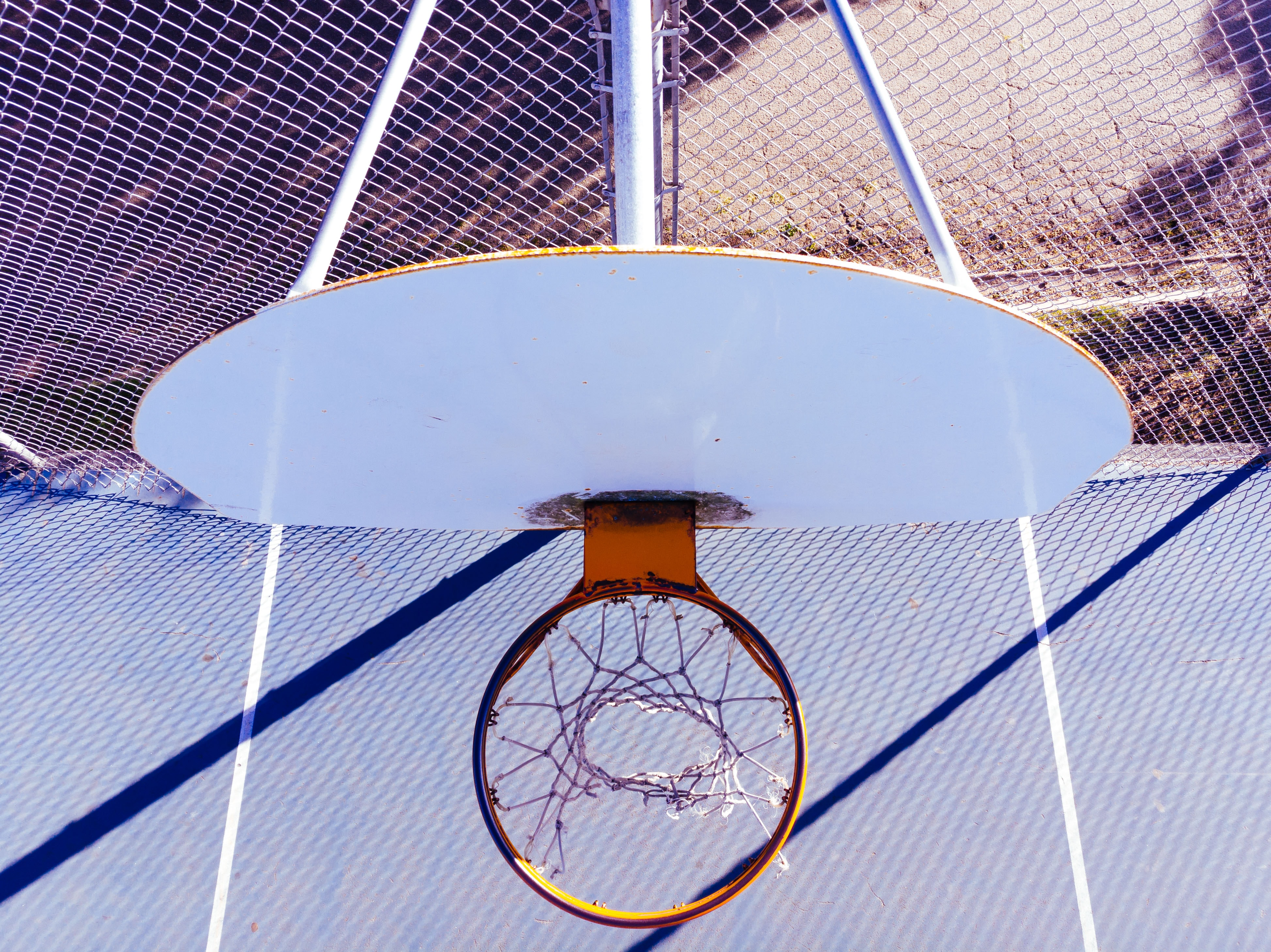 white and orange basketball hoop during day