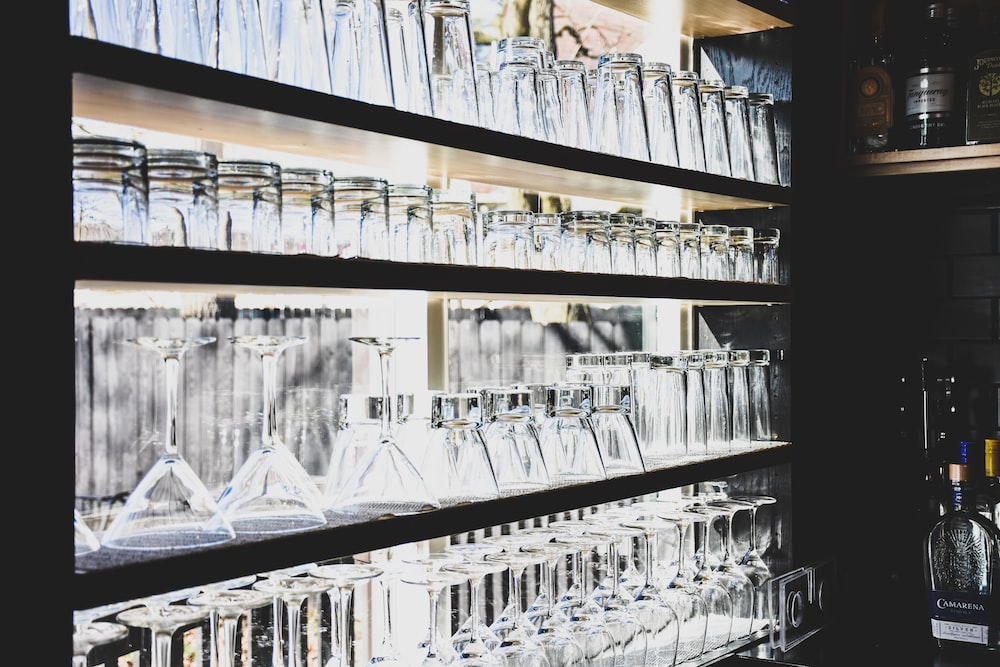 clear wine and martini glasses in the shelf