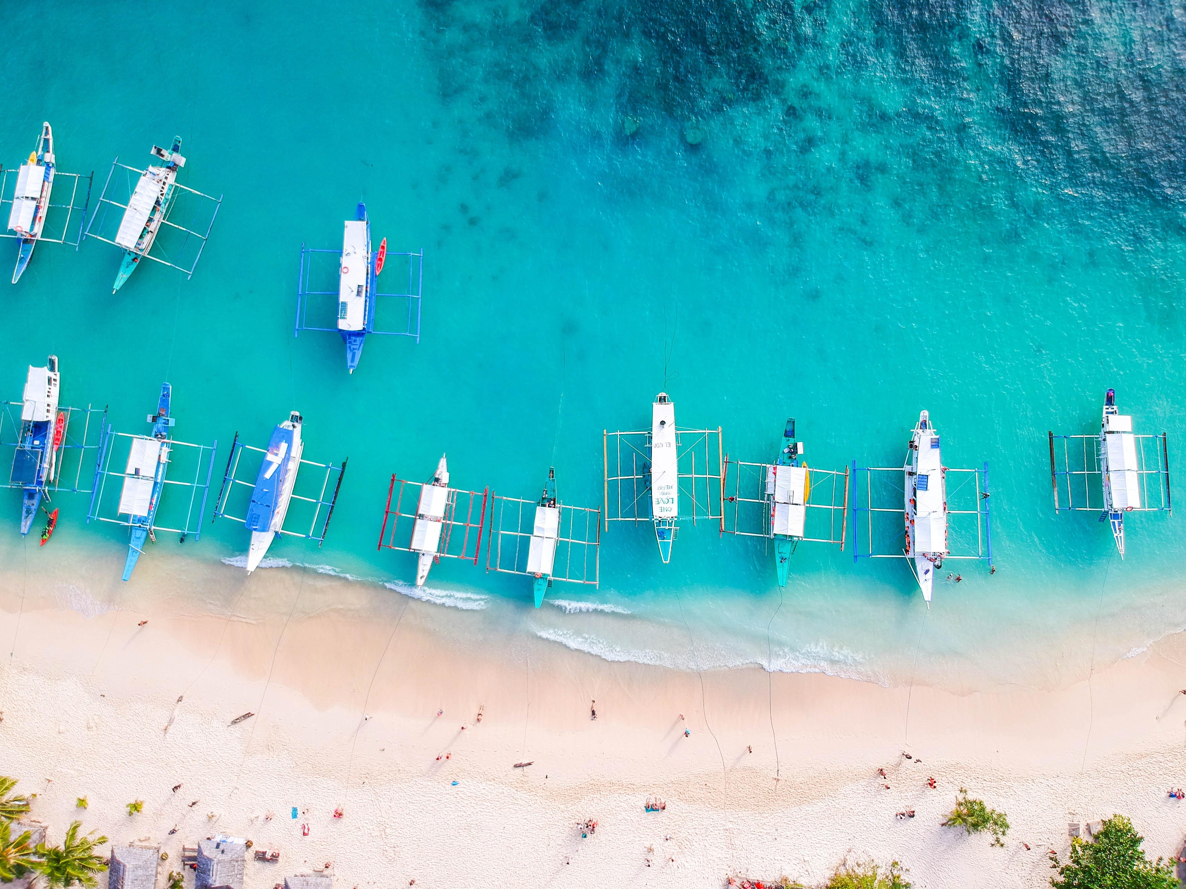 aligned boat seashore