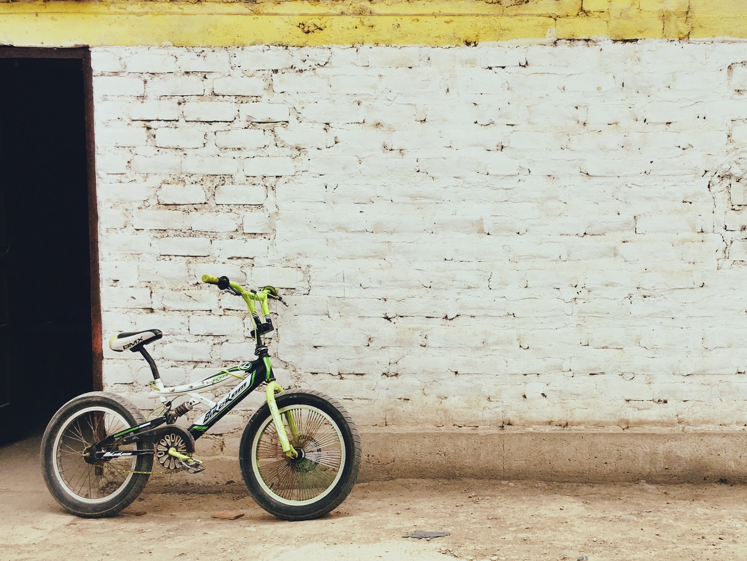 black and green full-suspension bike