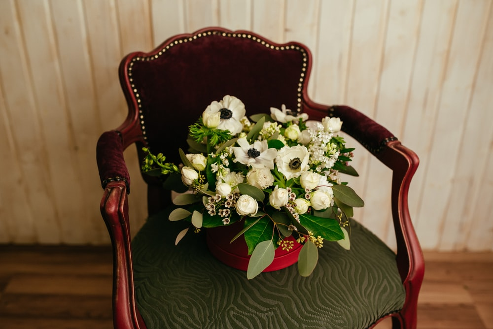 white flowers on wooden armchair