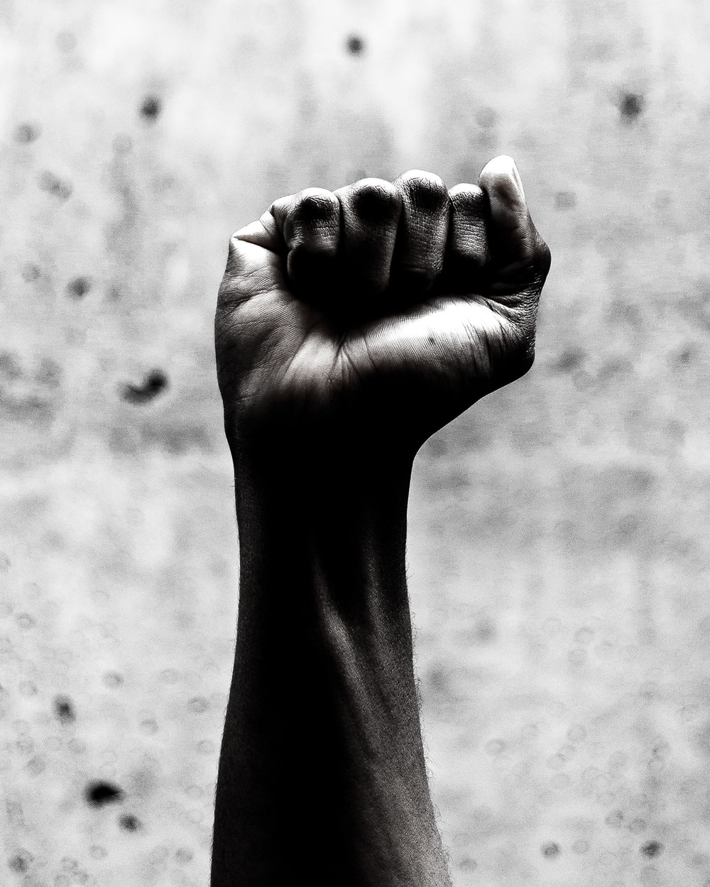 person's right fist grayscale photography