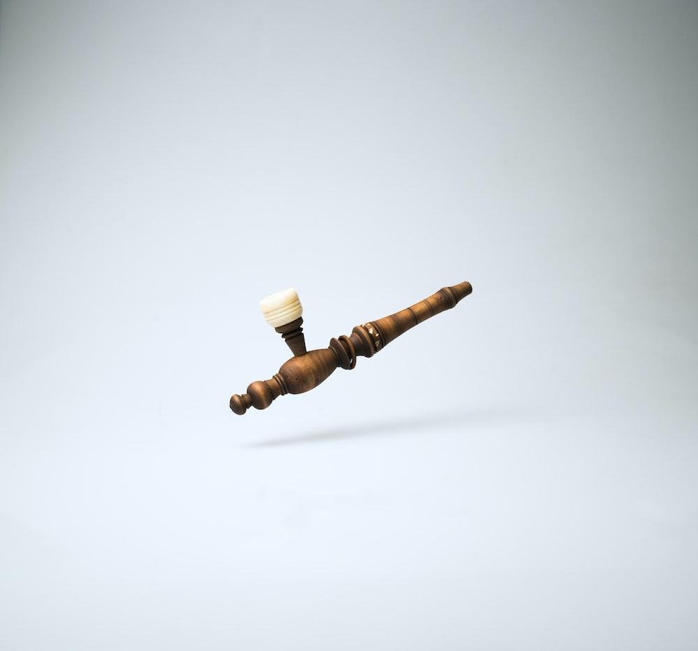 brown wooden smoking pipe