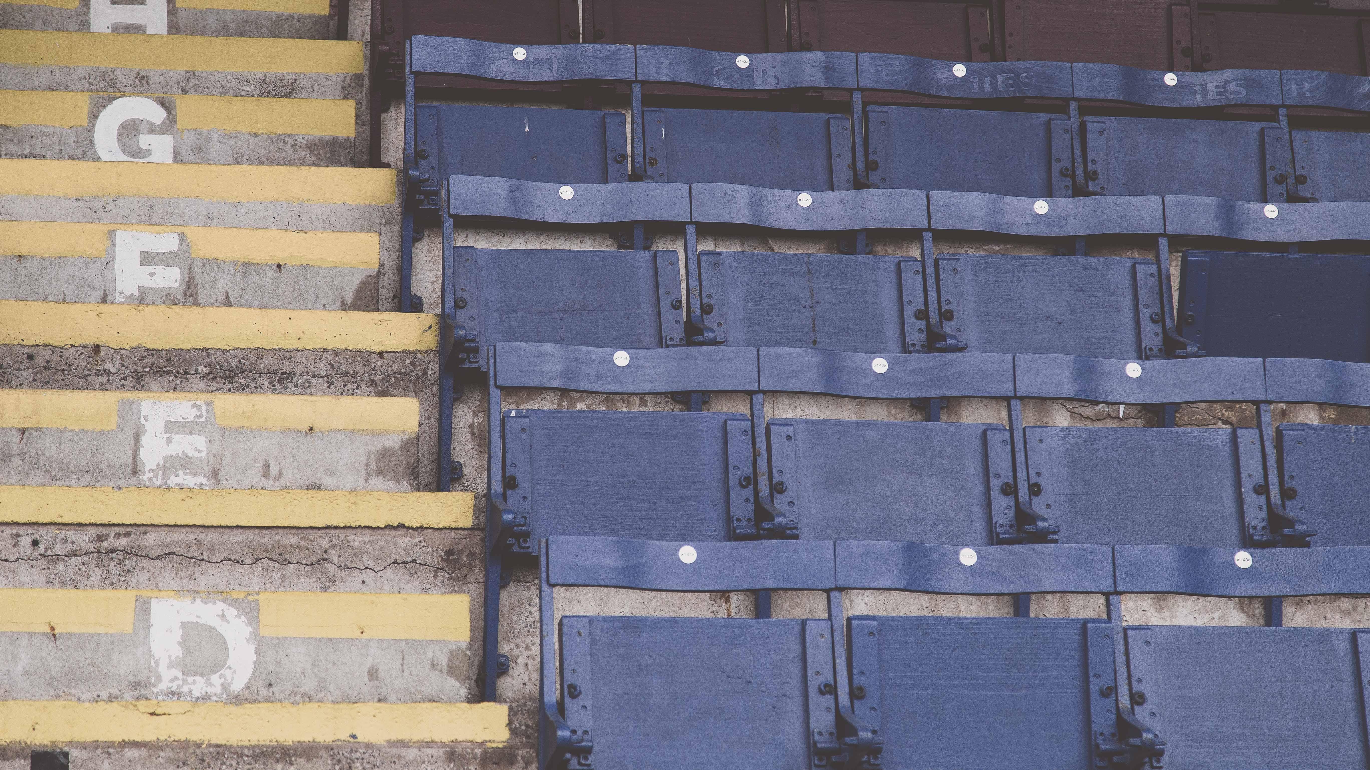 empty blue stadium chairs
