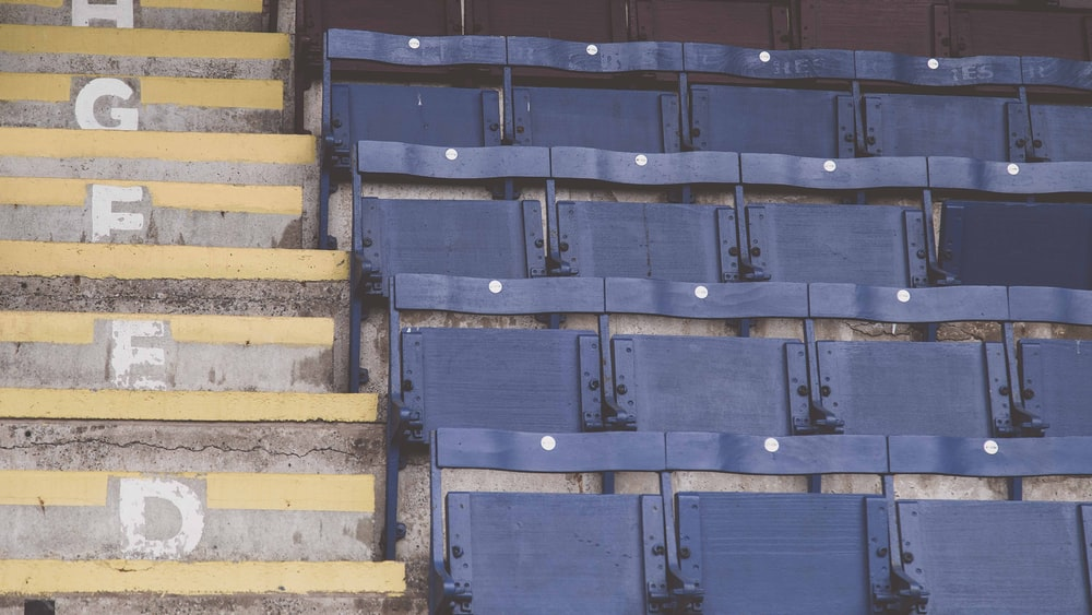 empty blue stadium chairs