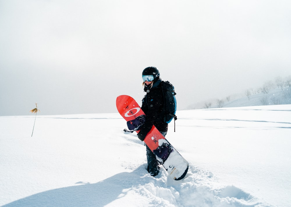 person holding snowboard