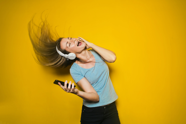 woman wearing white headphones