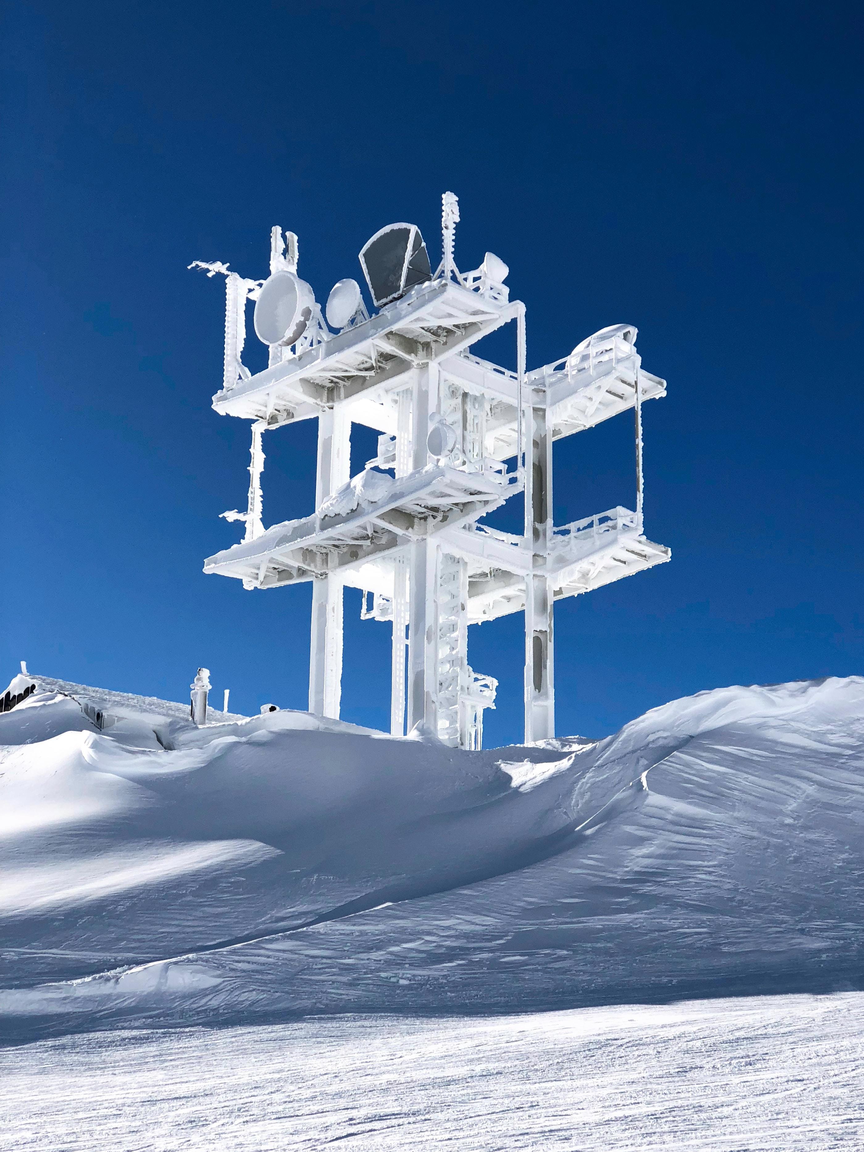 white satellite on snow covered hills