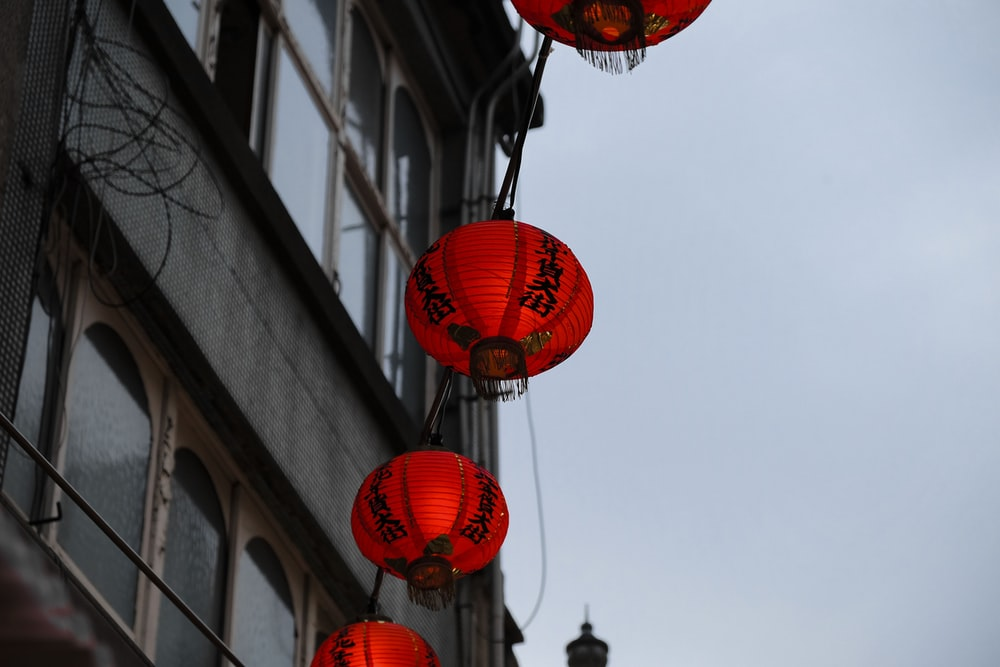 red oriental lamps hanged near building