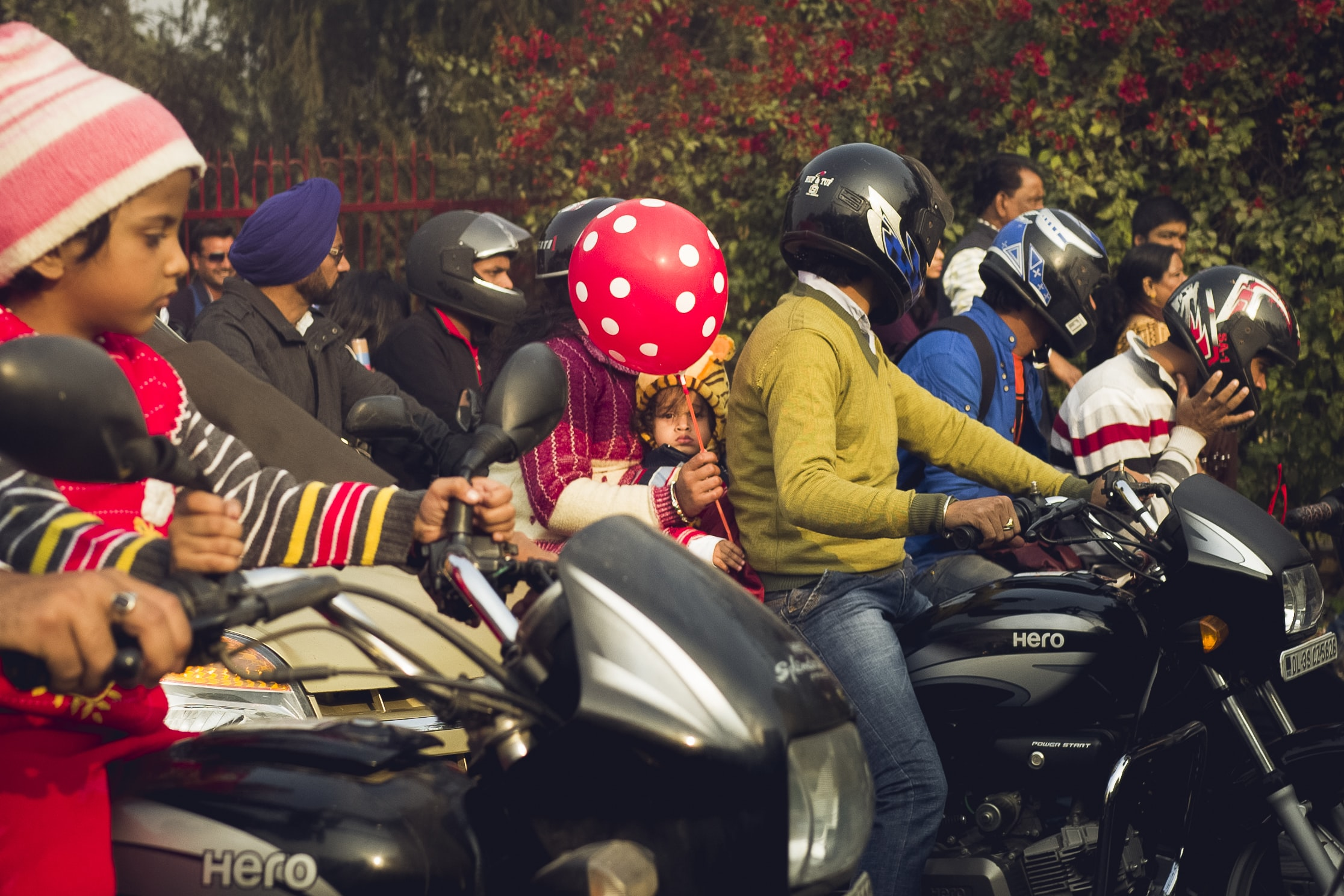 group of people riding motorcycle