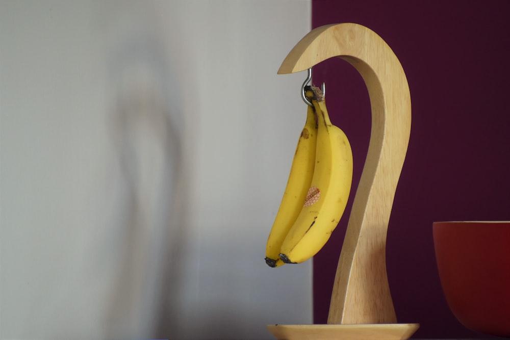 hanging yellow bananas on desk