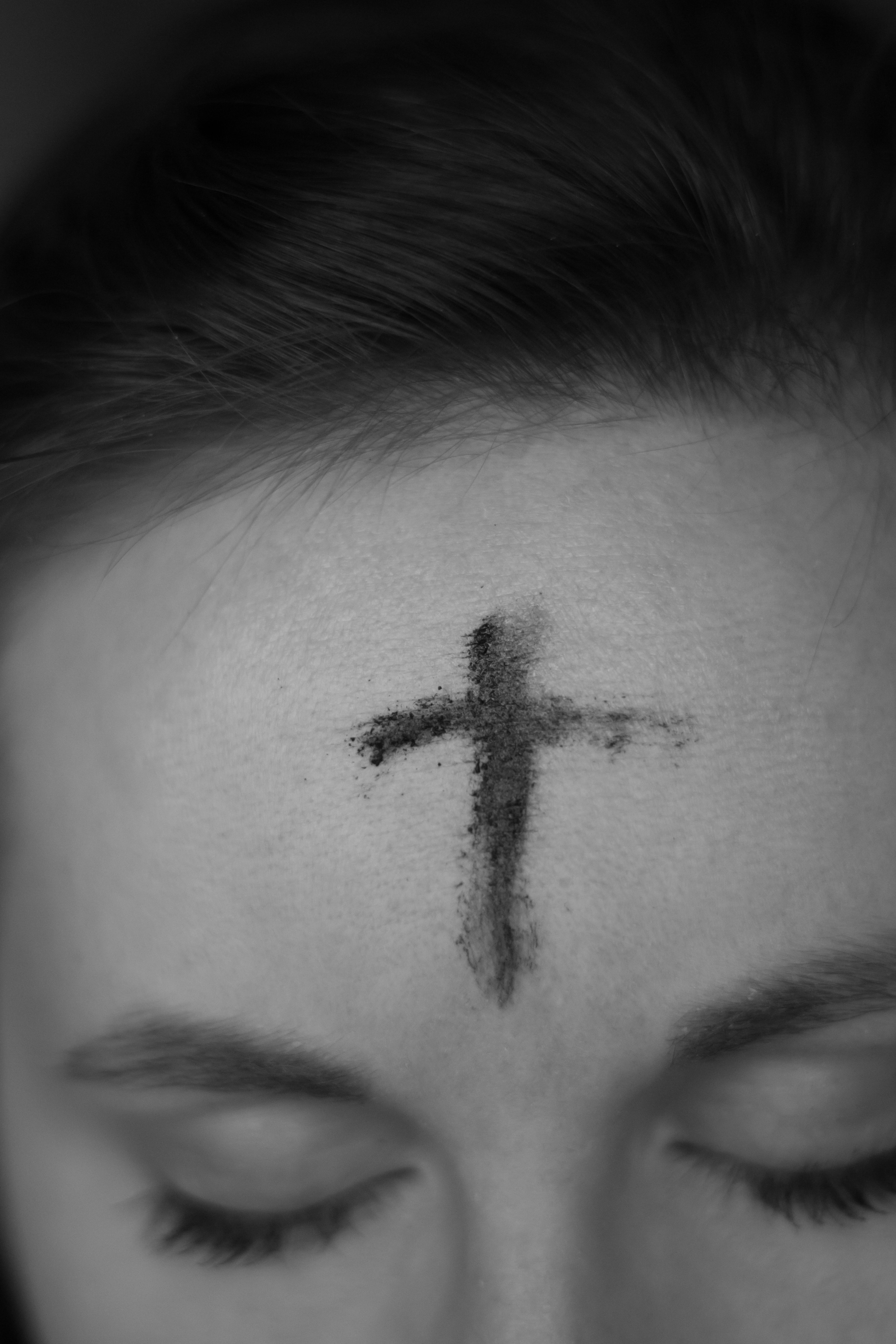 cross on person's forehead