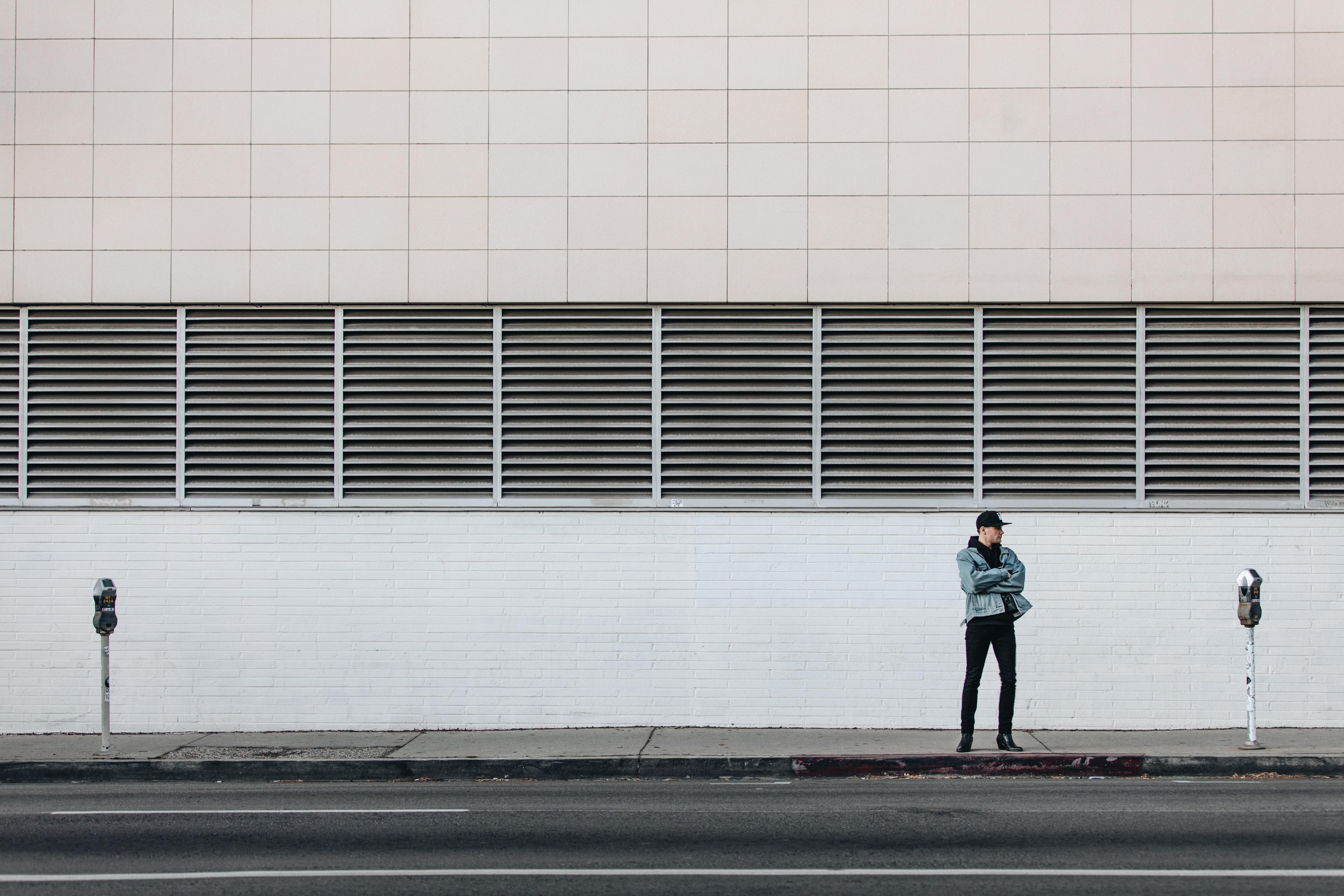 man standing on the sidewalk
