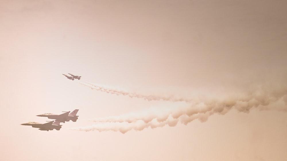four fighter jets on sky