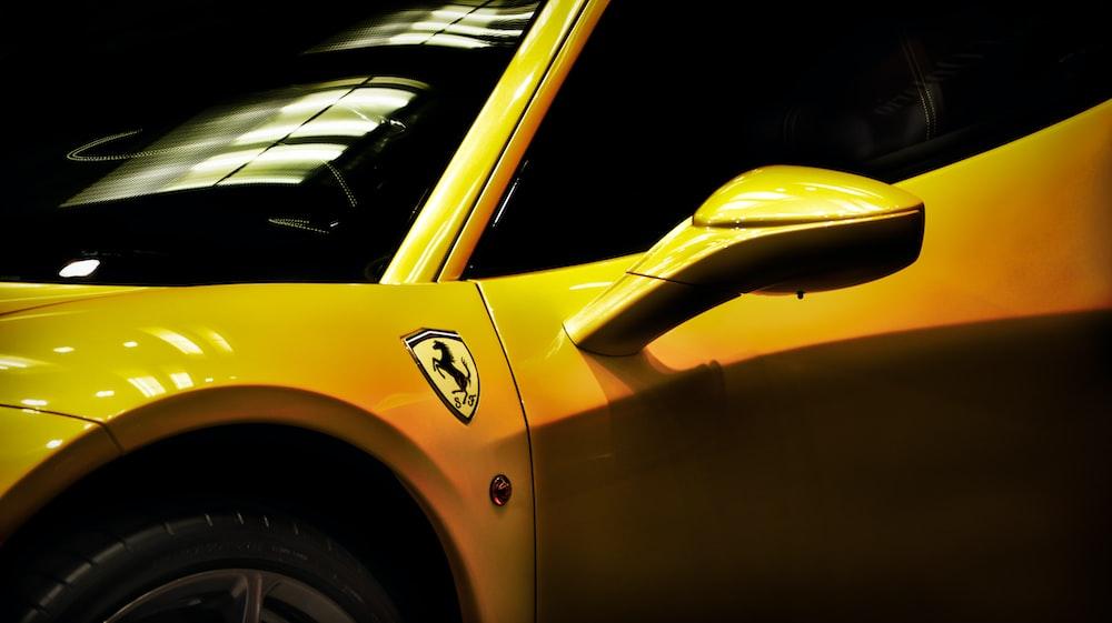 close shot of yellow Ferrari coupe