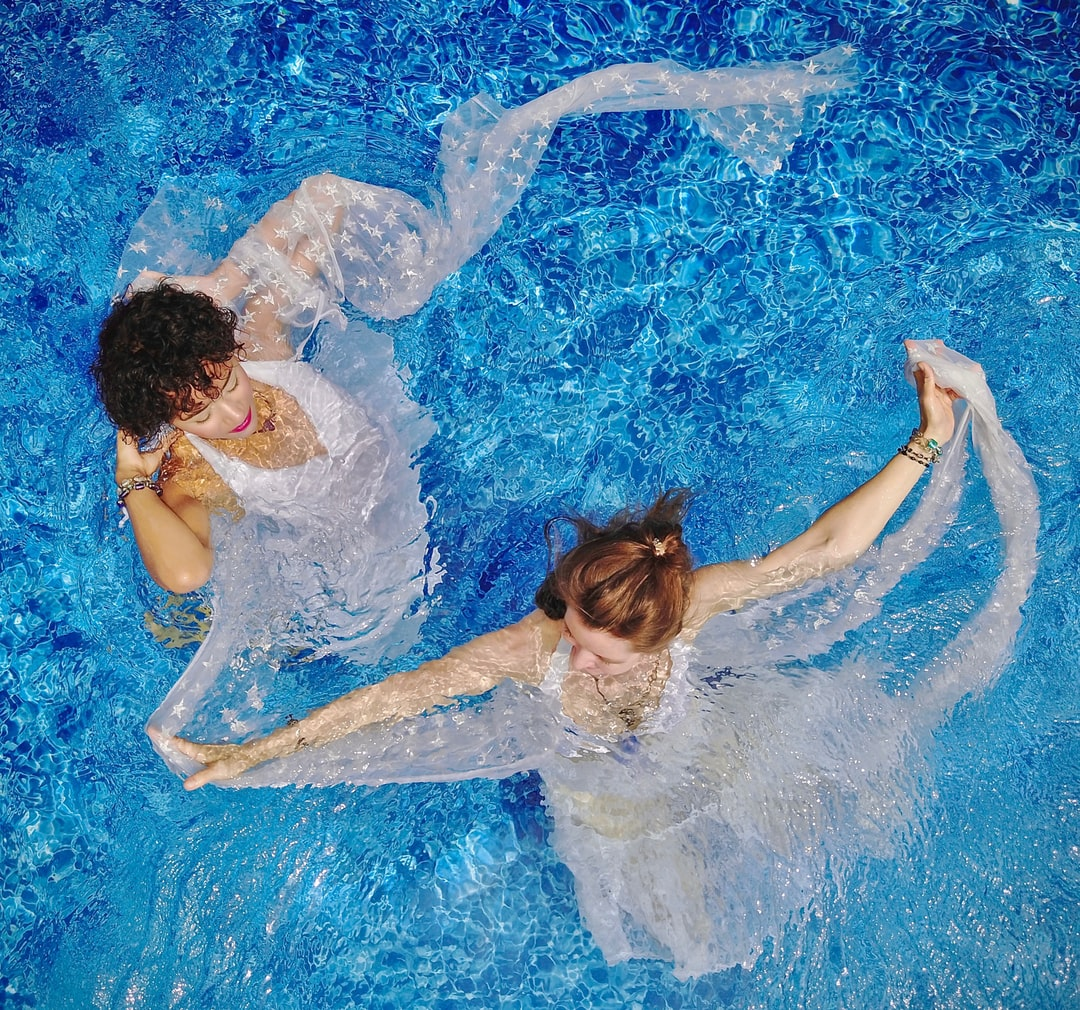 During an Underwater Fashion shoot two girls swirled around their dresses for a top-down aerial view with my drone.