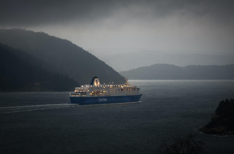 luxury ship on body of water near islands