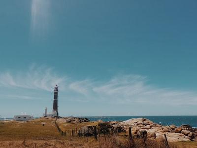 brown and white lighthouse during daytime uruguay teams background