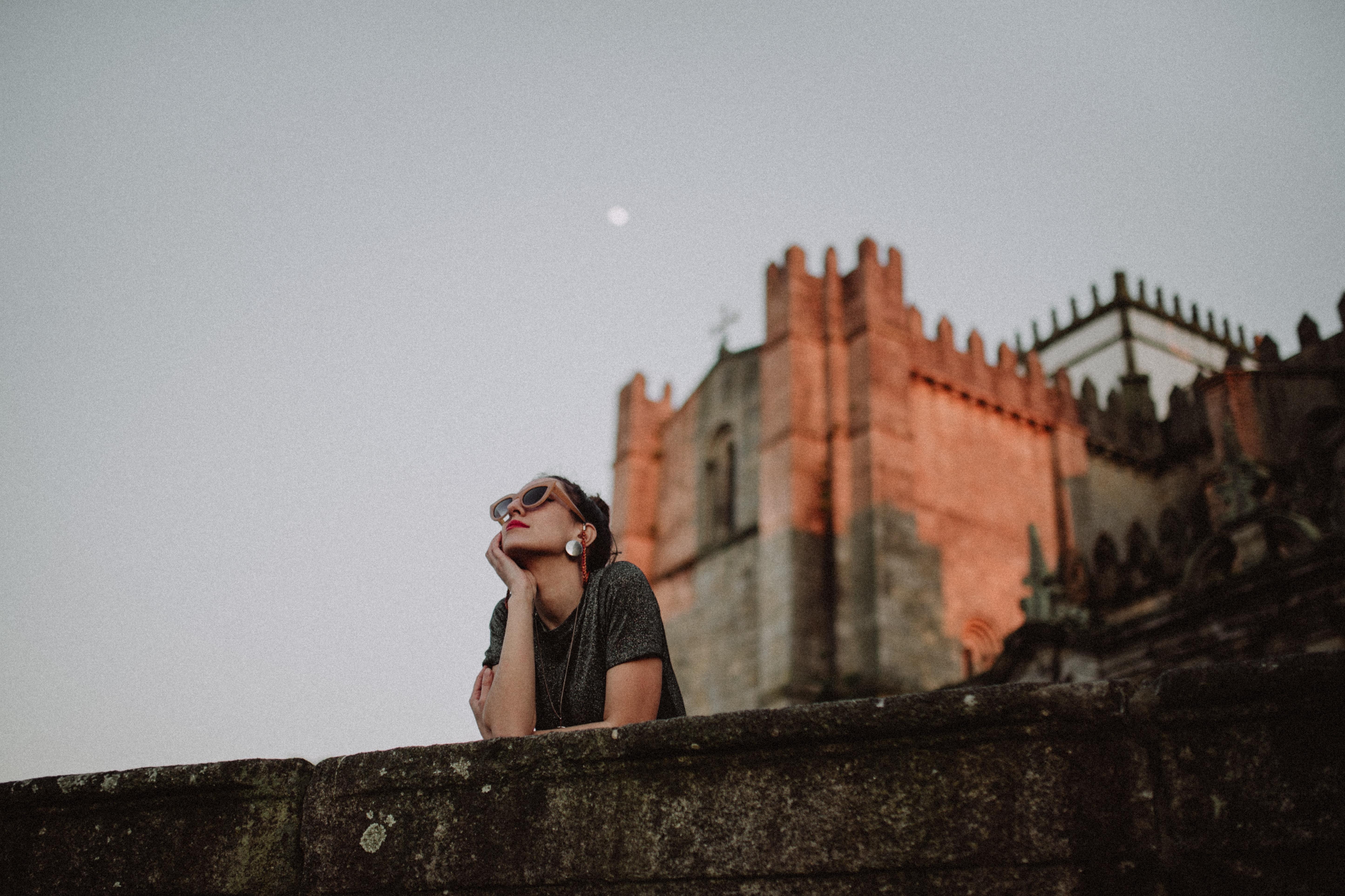 woman near stone castle