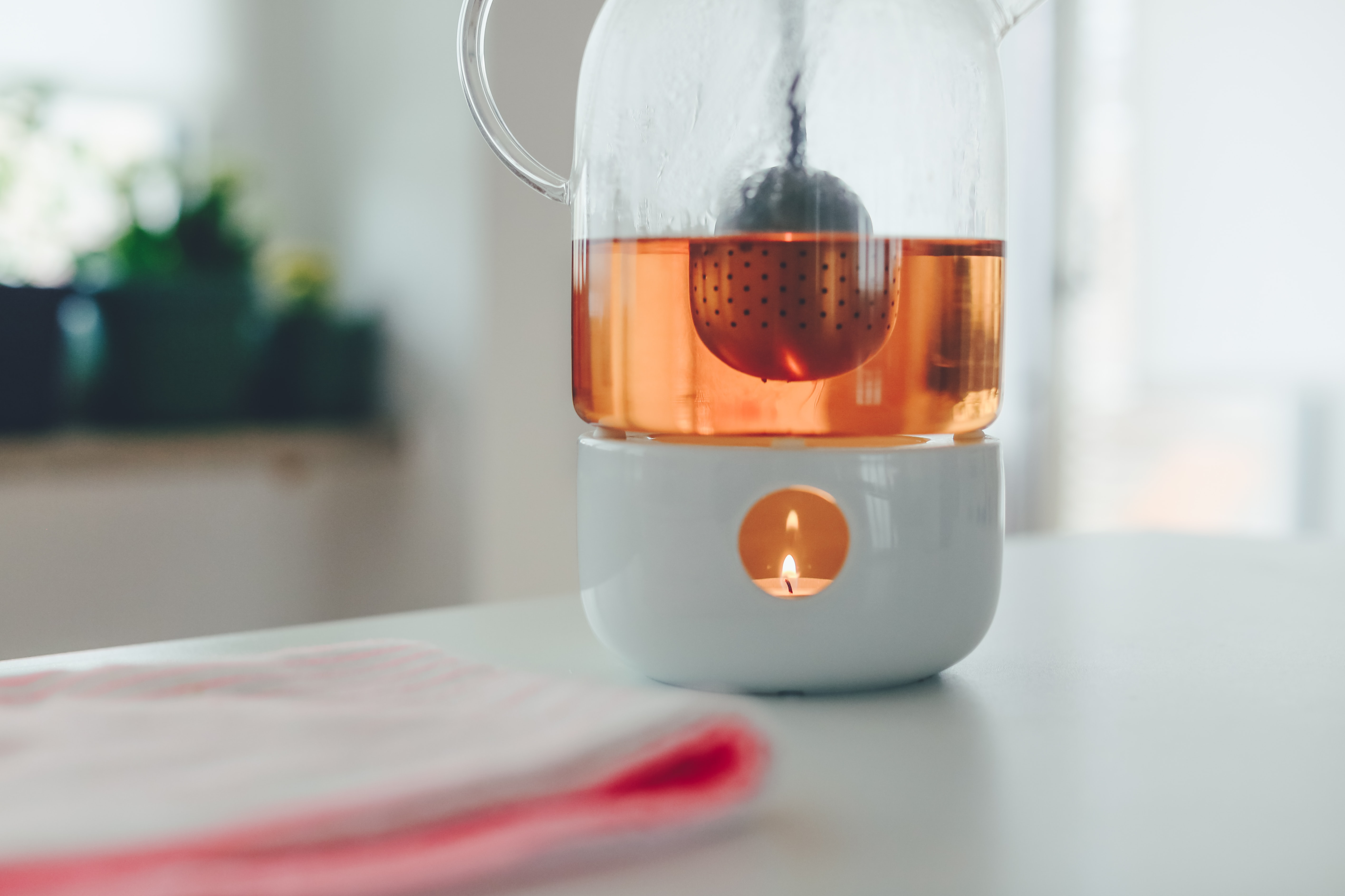 tealight candle with white holder on table