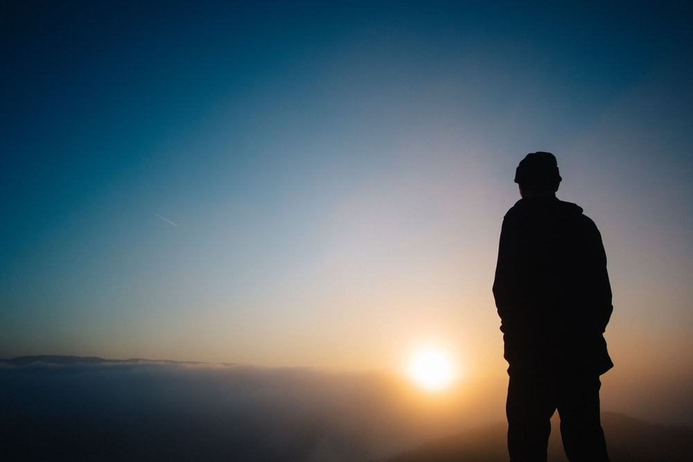 silhouette of a person during sunset