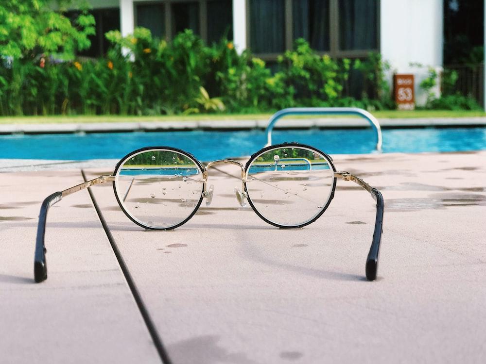 eyeglasses with black frames on white fabric