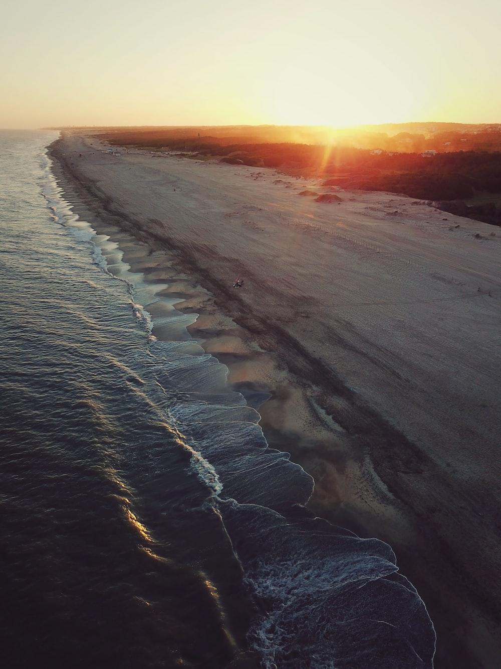 gray beach sand during golden hour