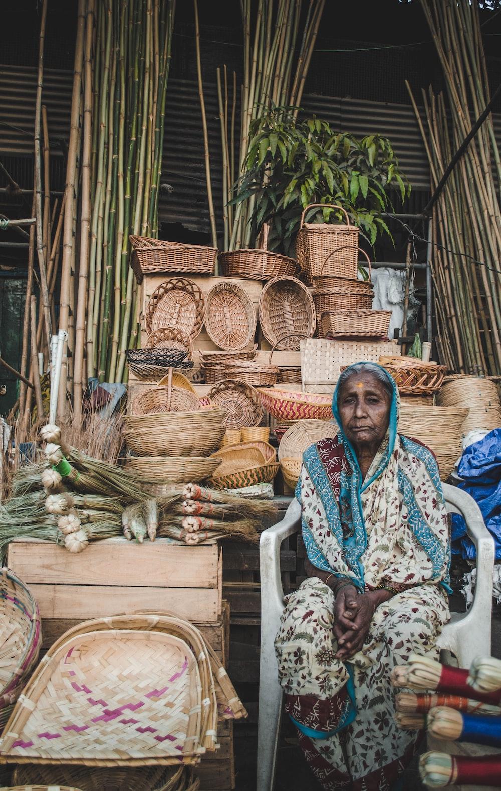 woman sitting on monobloc armchair