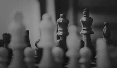 grayscale photography of chess board game