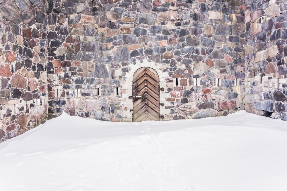 snow in front of wooden door