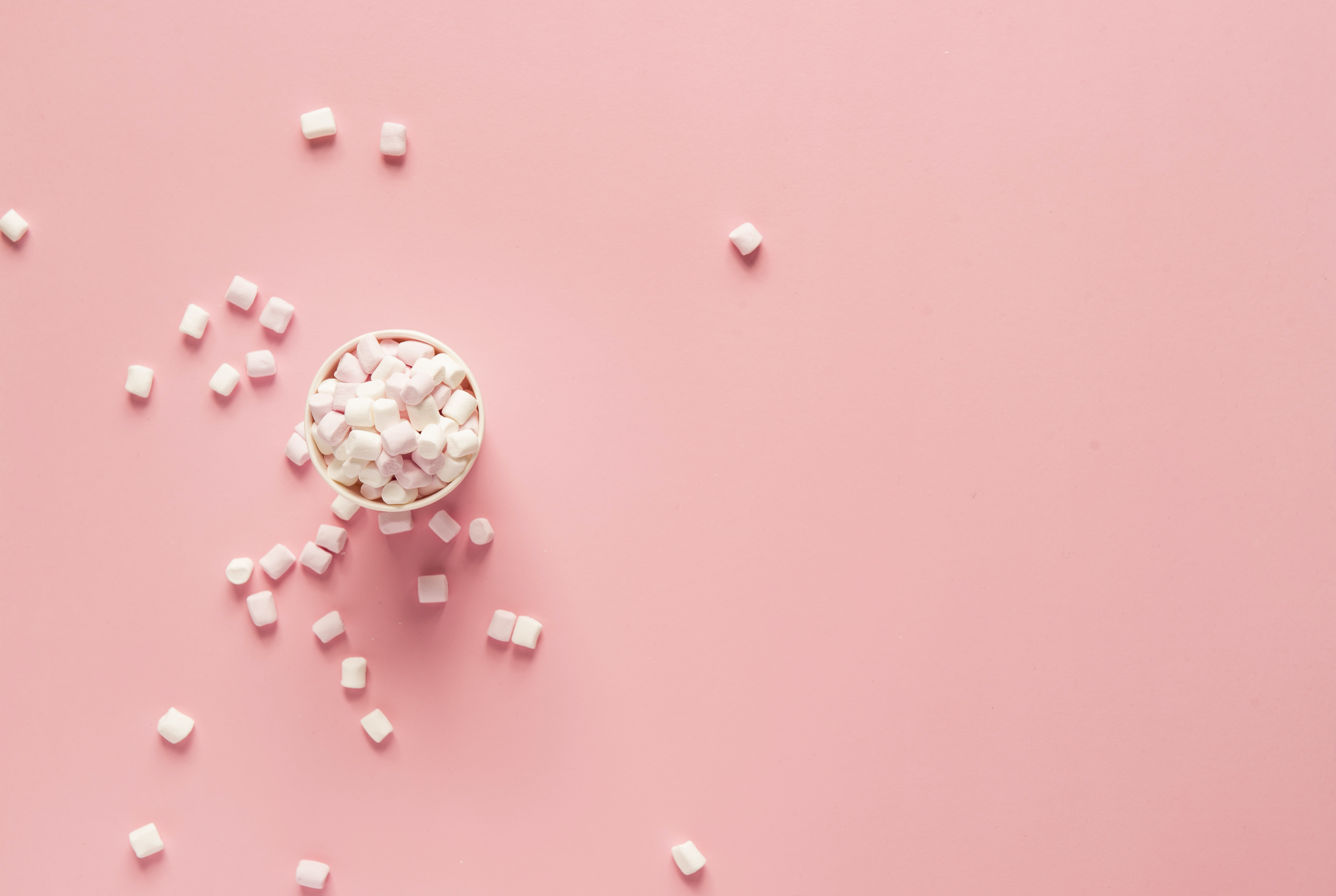 bunch of marshmallows on pink surface