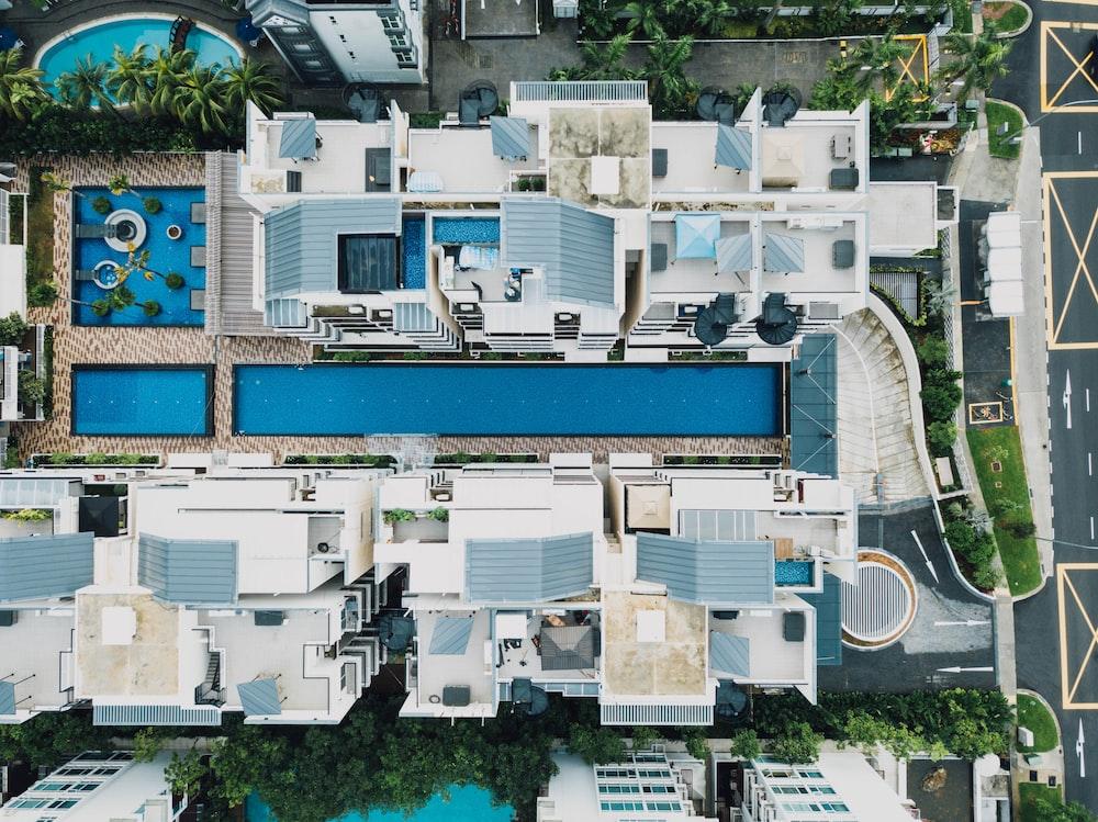 bird's eye view photo of pool between buildings