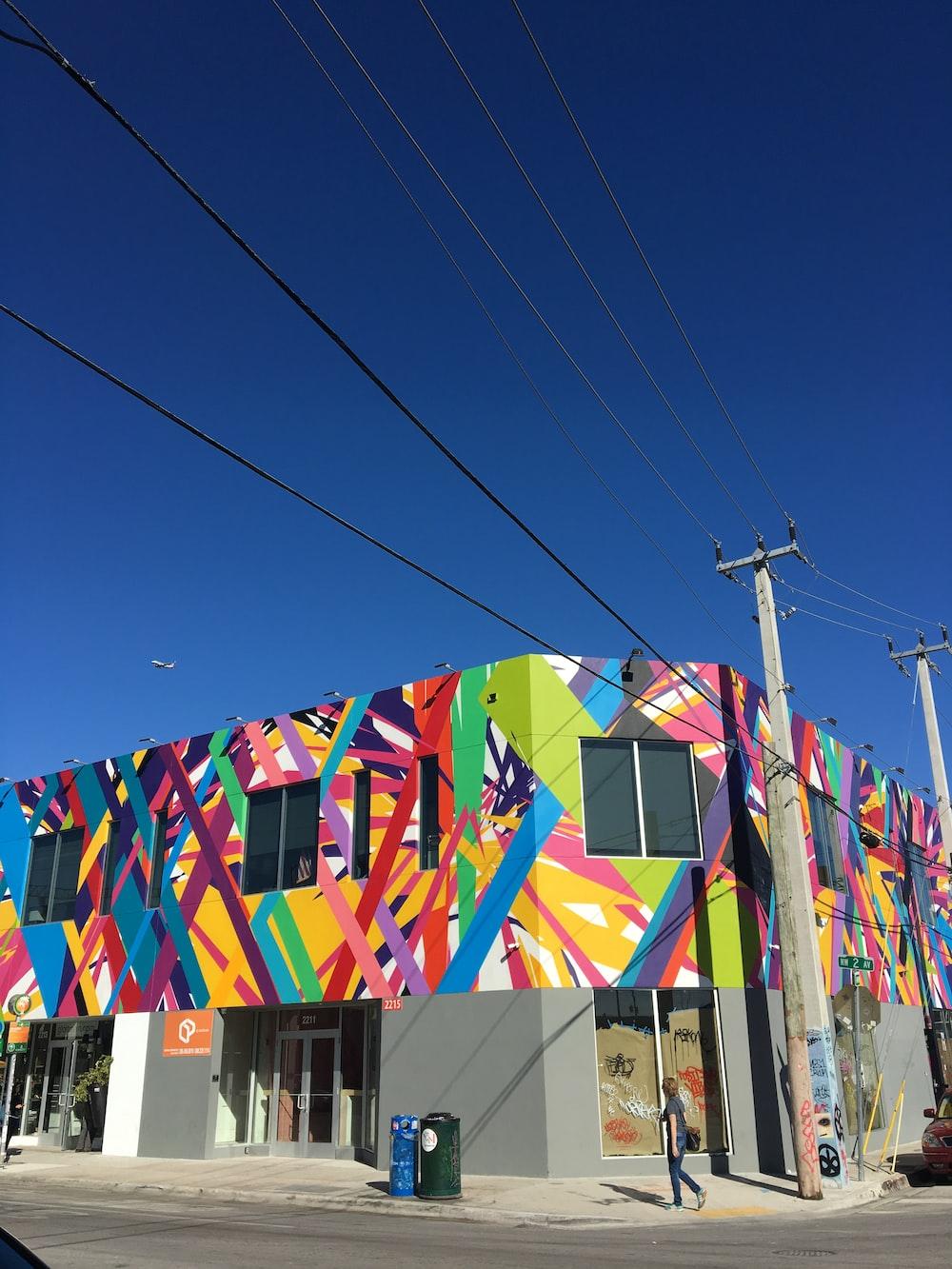 multicolored concrete building near power lines
