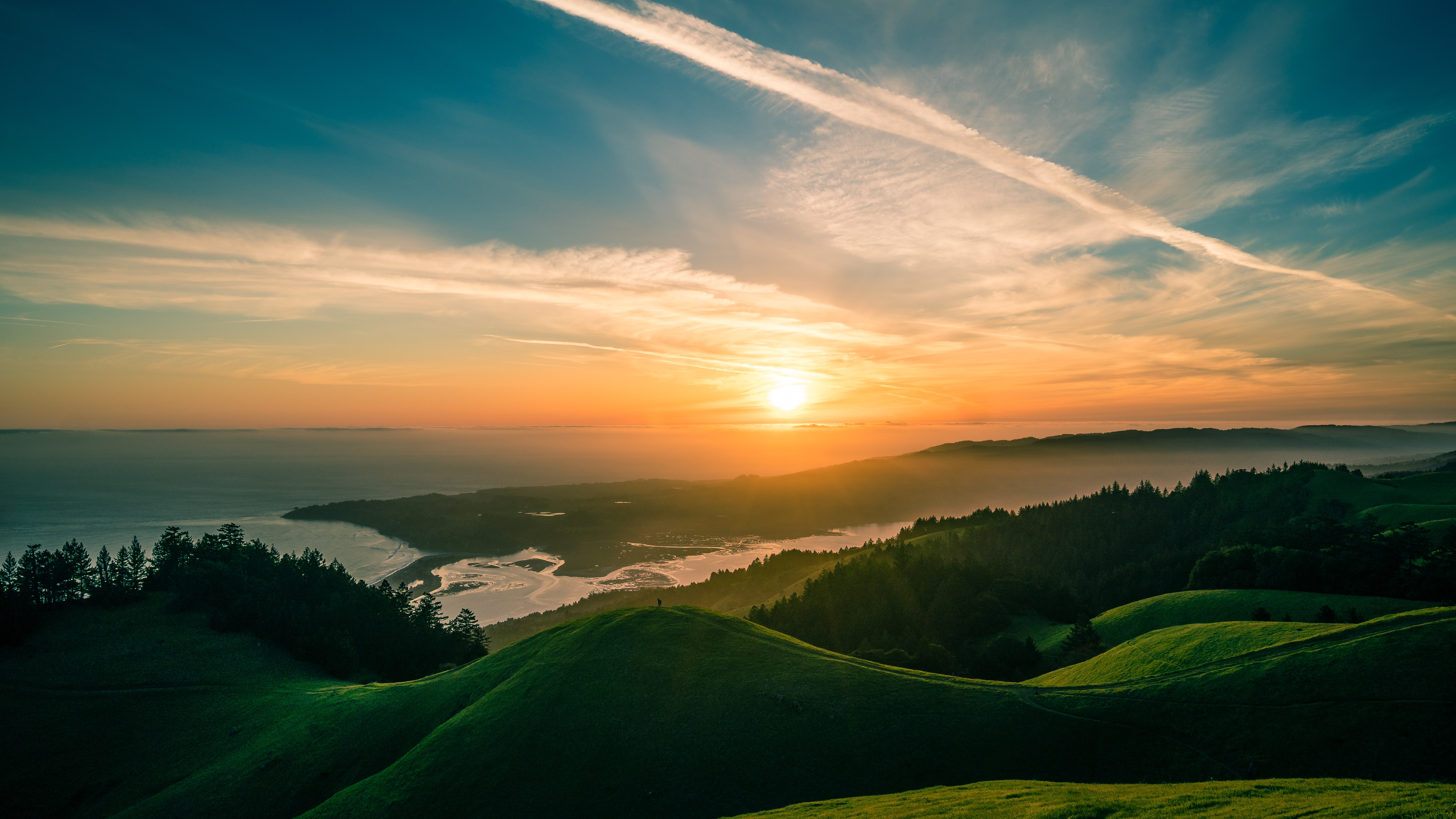 landscape photography of green mountains over the horizon
