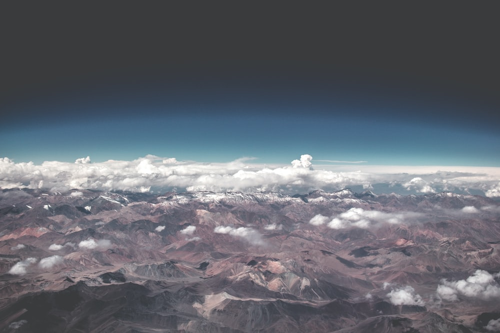 arial view of mountains with clouds