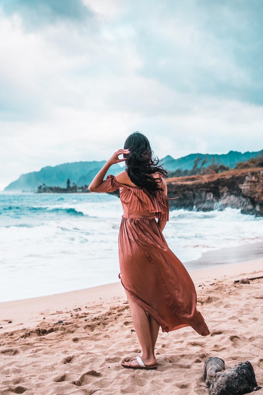 woman standing on brown sand